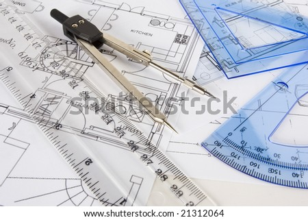 A random set of drawing instruments arranged on technical plans