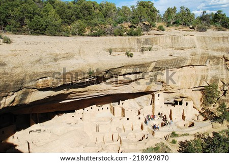 A ranger-guided tour in the ruins of Cliff Palace in Mesa Verde National Park, CO, USA. Mesa Verde was inhabited by the Ancestral Pueblo people from AD 600 to 1300.  - stock photo