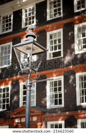 A rare example of a working London gas lamp in the Temple Bar legal district. - stock photo
