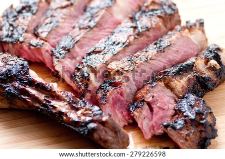 a rare rib steak cooked to perfection on the grill - stock photo