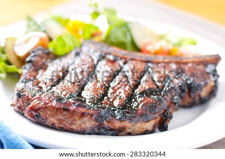 a rare rib steak cooked to perfection on the grill