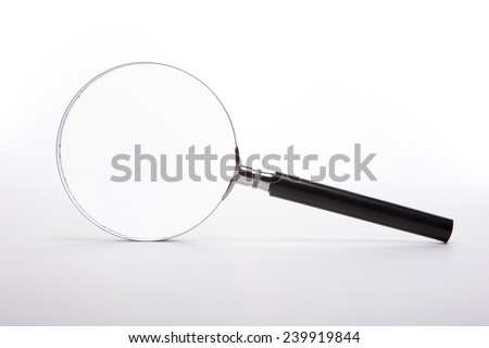 A reading glasses(magnifying glass[lens], magnifier) isolated white at the studio. - stock photo