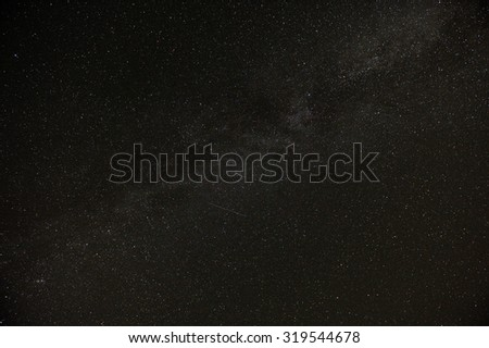 A real dark night sky with plenty of stars and flying satellites - stock photo