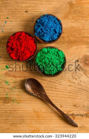 A real world rendition of the RGB colour system used in digital environments: red, green and blue powder pigments. - stock photo