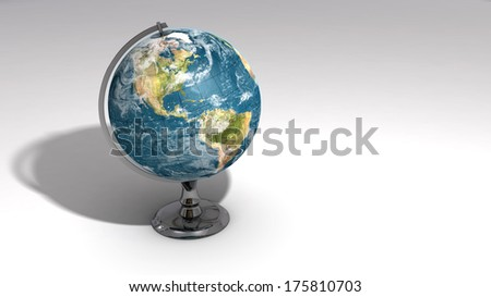 A realistic globe on a chrome pedestal over white featuring the western hemisphere. Some elements of this image furnished by NASA.
