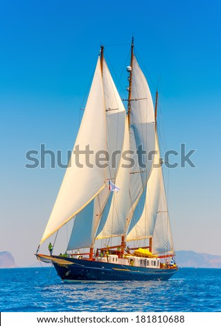 A really big 3 mast old classic wooden sailing boat during a Classic Boats Regatta in Spetses island in Greece