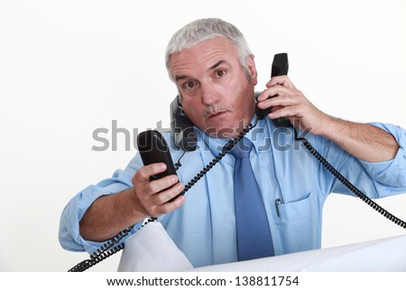 A really busy businessman. - stock photo