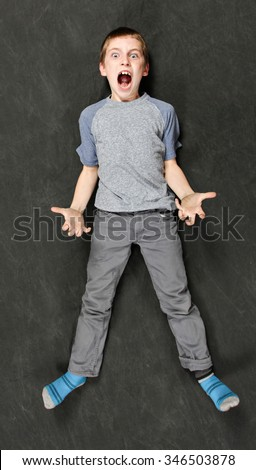 A really mad boy throwing a tantrum - stock photo