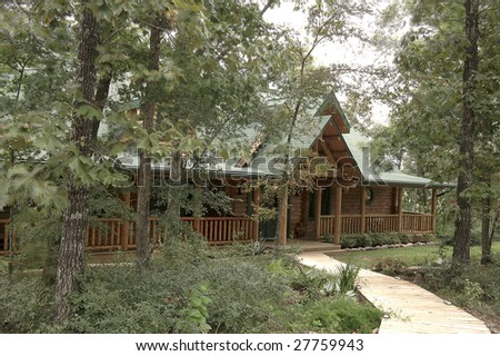 A recently completed log house located in a rural area.