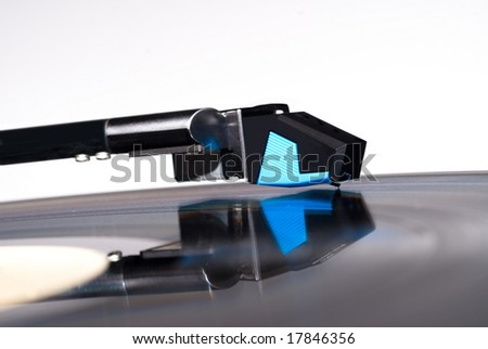 A record album playing on a turntable isolated on white.