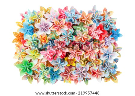 A rectangle pile of colorful paper flowers isolated on a white background - stock photo