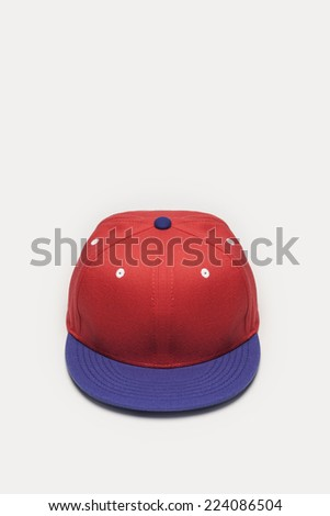 A red and blue cap top-side view isolated white background. - stock photo