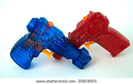 A red and blue water pistol isolation - stock photo