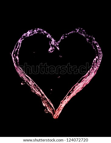 A Red and Purple Heart made out of Watersplashes Isolated on a Black Background