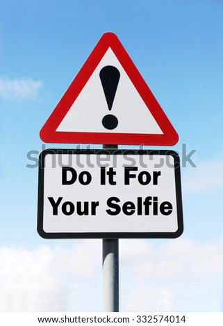A red and white triangular road sign with a Do It For Your Selfie play on words concept against a partly cloudy sky.