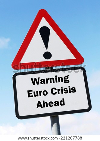 A red and white triangular road sign with a warning about a Euro Crisis concept against a partly cloudy sky. - stock photo