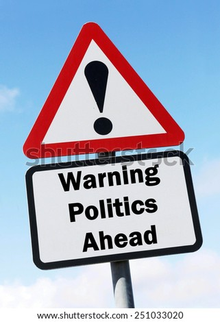 A red and white triangular road sign with a warning about politics ahead concept against a partly cloudy sky. - stock photo