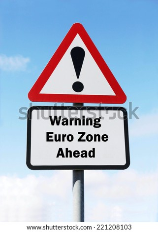 A red and white triangular road sign with a warning about the Euro Zone concept against a partly cloudy sky.