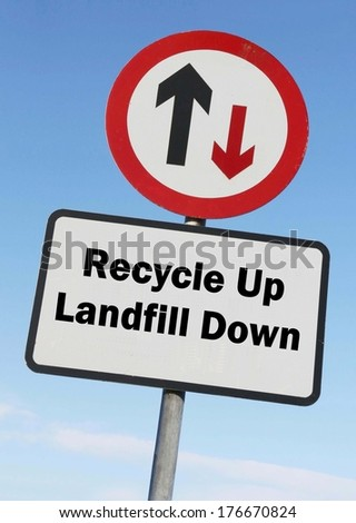 A red and white warning roadsign with a Recycle up, Landfill down concept. against a partly cloudy sky background  - stock photo