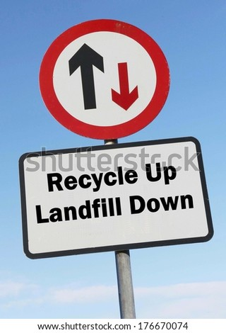 A red and white warning roadsign with an Re cycle up, landfill down concept. against a partly cloudy sky background  - stock photo