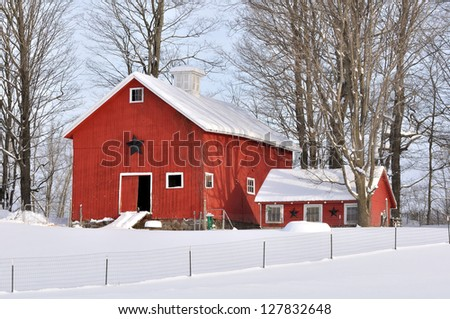 A red barn in Upstate New York after a snow storm with primitive country stars