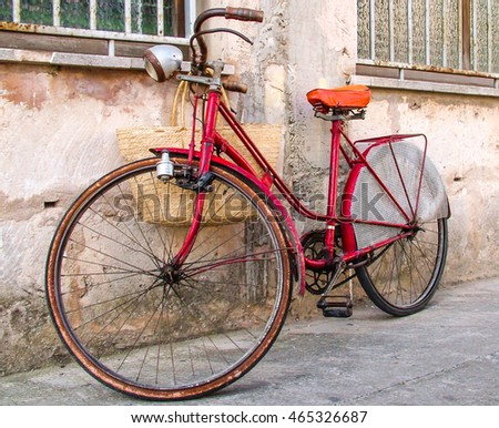 A red bicycle leaning at the wall (Mallorca, Spain)
