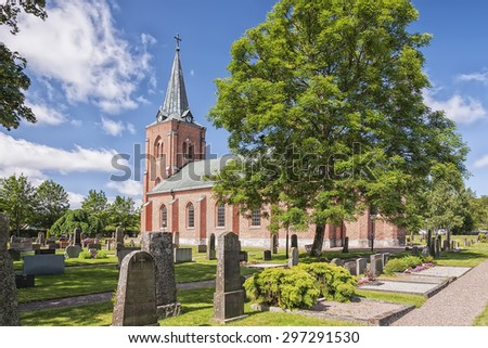 A red brick church in the Swedish town of Rya. - stock photo