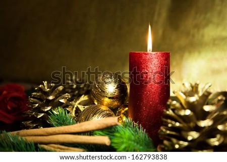 A red candle and a golden background - stock photo