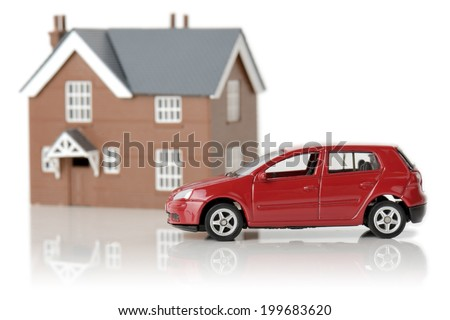 a red car and house isolated on a white background - stock photo