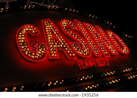 A red Casino sign with bulbs advertising penny slots  - stock photo