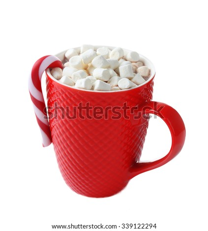 A red cup of cocoa, marshmallow and Christmas candy, isolated on white - stock photo