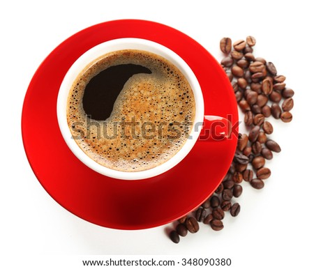 A red cup of tasty drink and scattered coffee grains, isolated on white, top view - stock photo