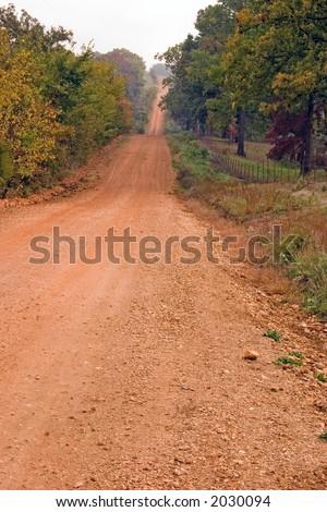 A red dirt road in rural Arkansas - stock photo