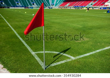 A Red flag at one corner of football stadium and soccer corner of a soccer field - stock photo