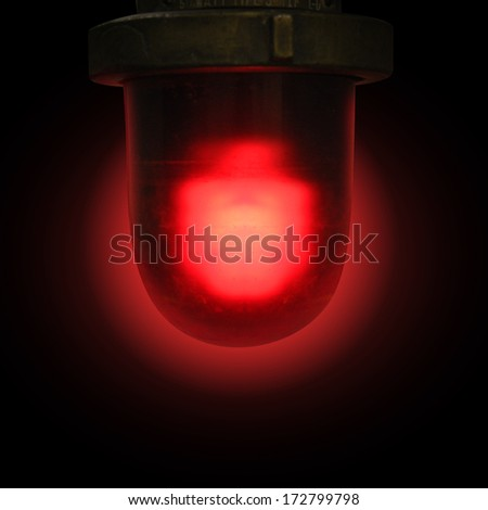 A red flashing siren is on a black isolated background for an emergency or danger concept. - stock photo