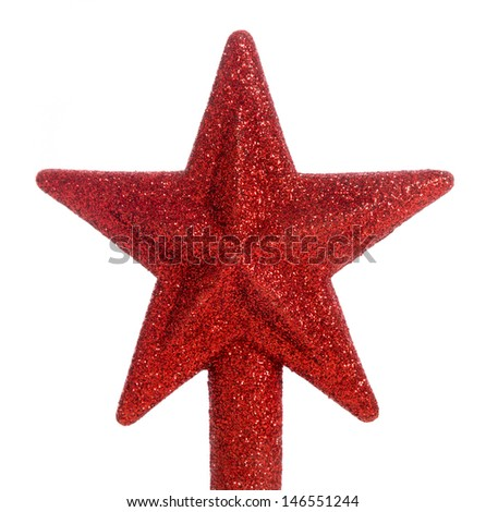 A red glittered star Christmas tree topper - stock photo