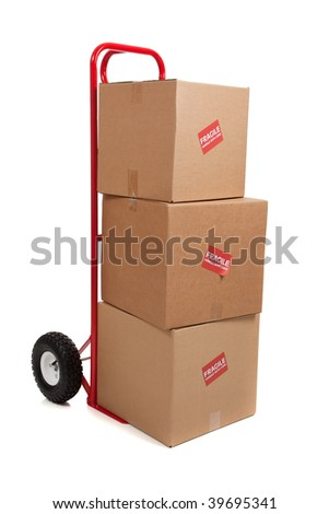 A red hand truck/dolly on a white background with three brown cardboard boxes with fragile stickers