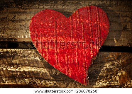 a red heart decoration wood background - stock photo