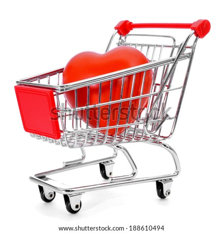 a red heart in a shopping cart on a white background - stock photo