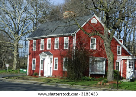 A red house during a later summer afternoon - stock photo