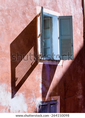 a red house with windows and shutters - stock photo