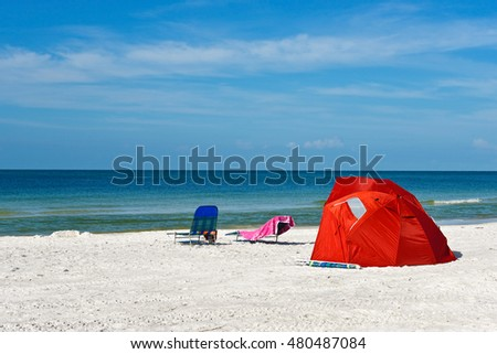A Red Kids Beach Shelter and Chairs on the Sandy Beach of Anna Maria Island,, Florida