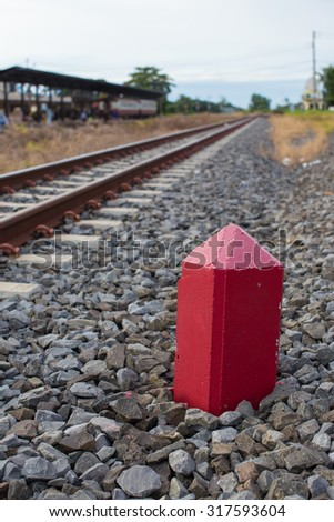 a red kilometer stone  Side Tracks - stock photo