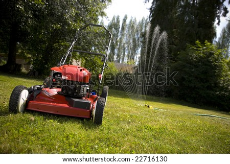 A red lawn mower in fresh cut grass.