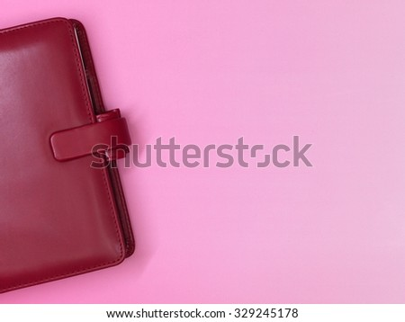 A red leather business notebook binder - stock photo