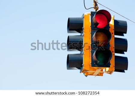 A red light traffic signal with blue sky copy space - stock photo