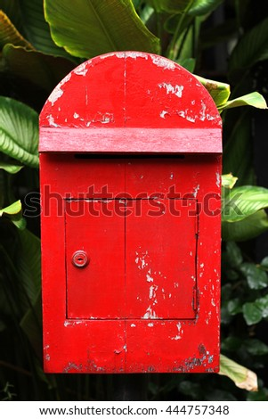 A Red  Mail post box. - stock photo