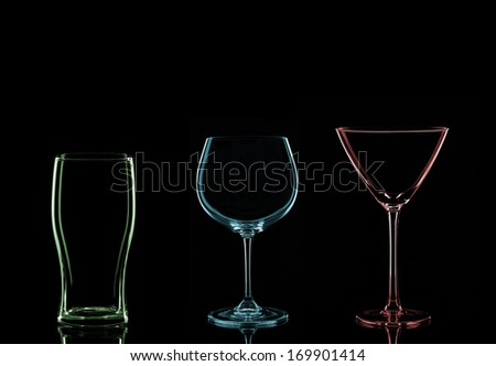 A Red Martini Glass, a Blue Wine Glass and a Green Pint Glass on a Black Background