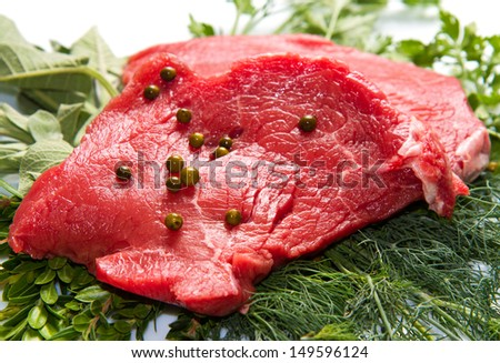 a red meat with  rosemary isolated on white background  - stock photo