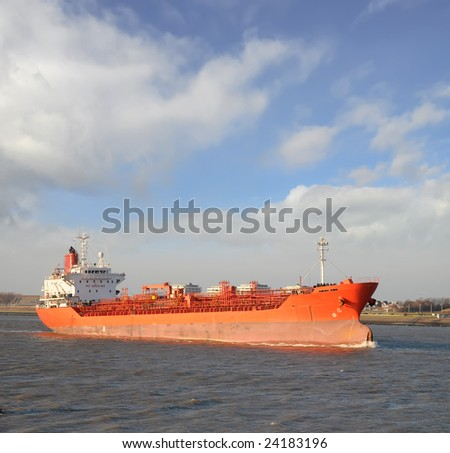 A red oil tanker on its way to the Port of Rotterdam the Netherlands - stock photo